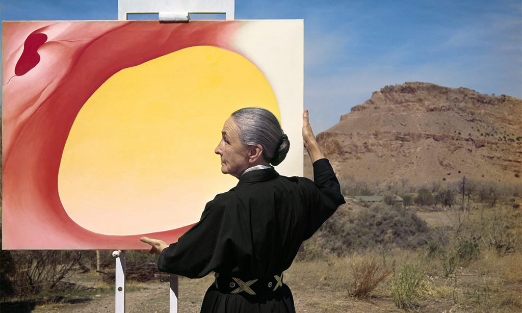 "Tony Vaccaro, Georgia O'Keefe with ""Pelvis Series, Red with Yellow"" and the desert, 1960. Georgia O'Keeffe Museum. Courtesy of Tony Vaccaro studio."